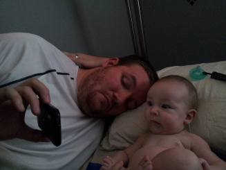Daddy and Logan watching a Dr Seuss Book