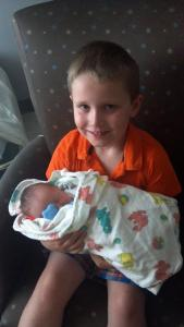 Lucas with his new baby brother