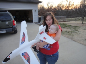Logan getting ready to fly his first foam airplane :) And...check out the new kicks :)